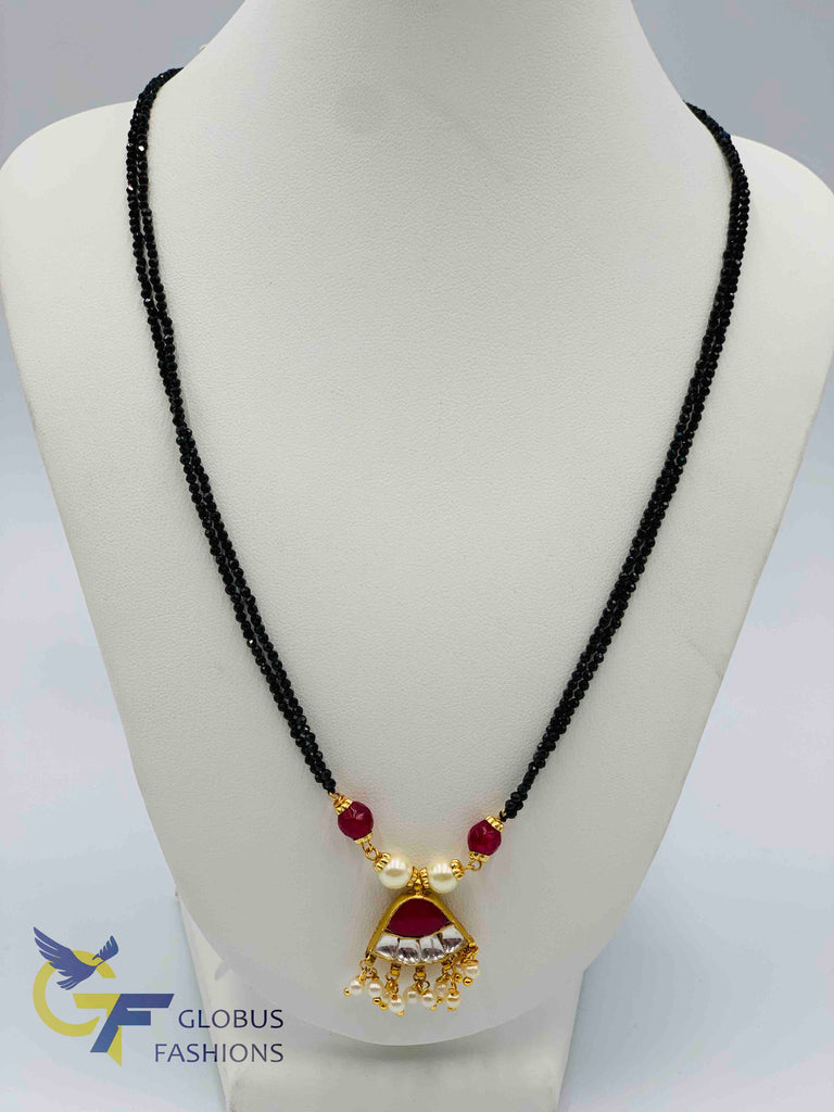 Traditional kundan and ruby stones with pearls pendant with black diamond beads chain