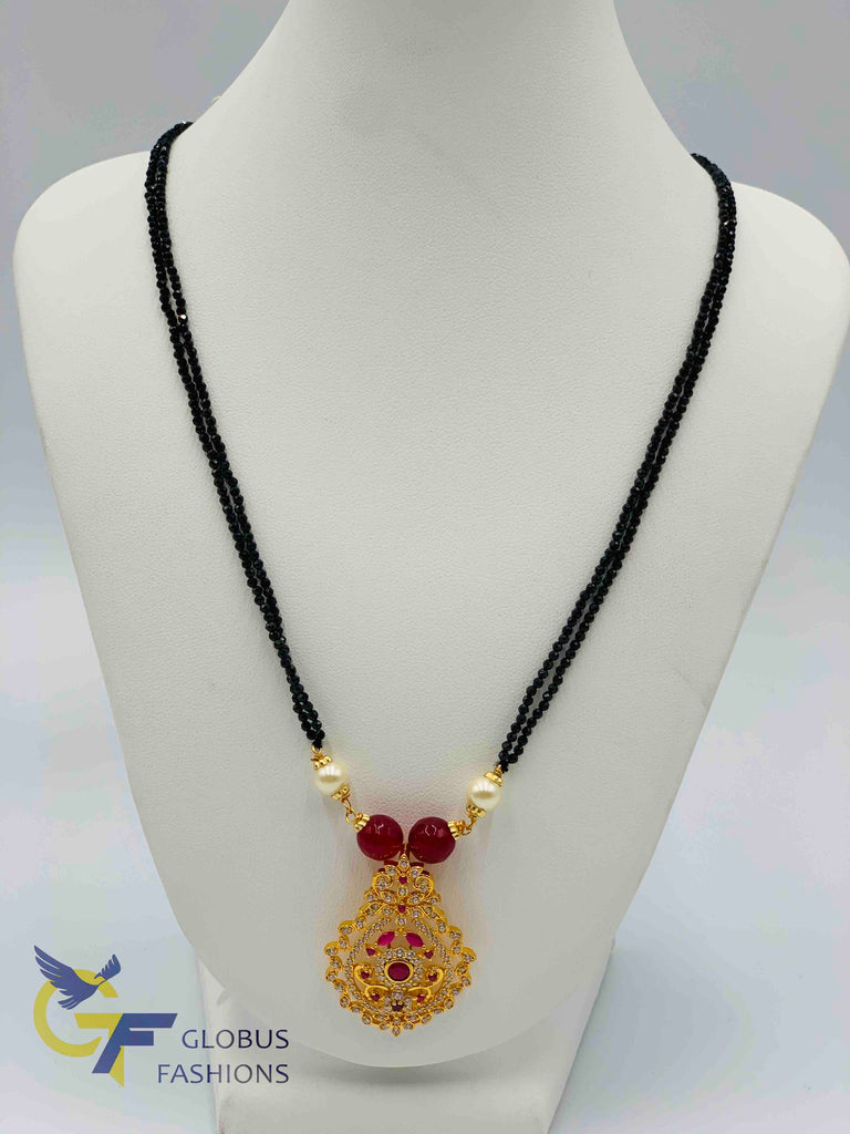Cz stones and ruby stones pendant with black diamond beads chain