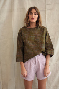 The Painters Blouse - hand-woven khaki in dark olive with a rainbow grid..