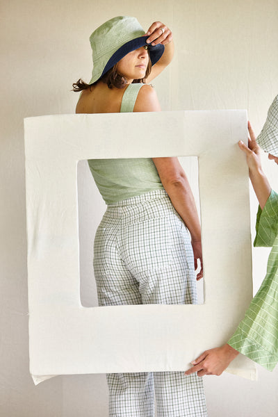 The cuff pants - white with green grid in hand woven cotton khadi.