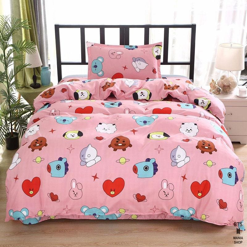 a bed with a pink blanket