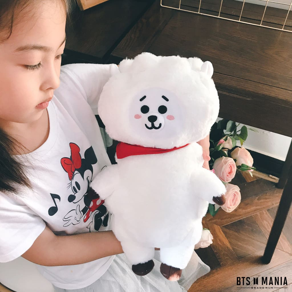 a small child is holding a stuffed animal