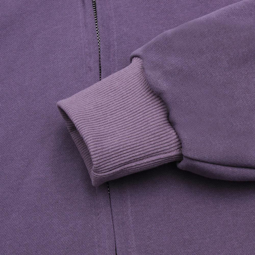 a bed with a purple blanket