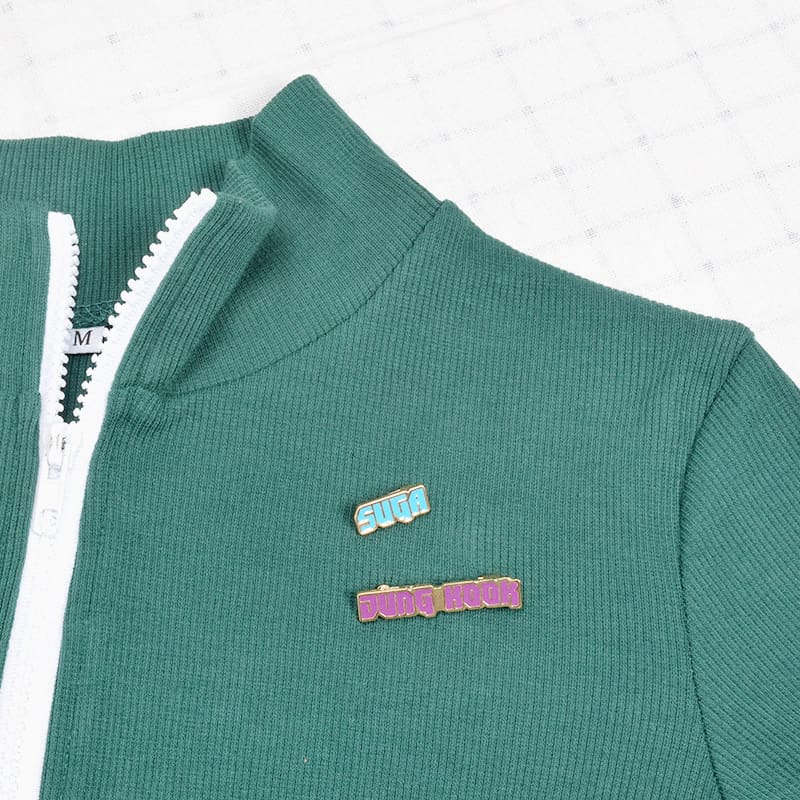 a close up of a green sweater