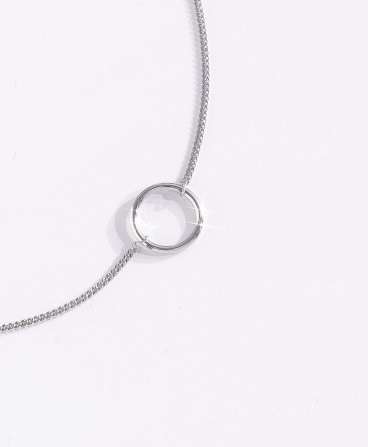 a necklace on a white surface