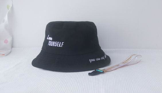 a white and black hat