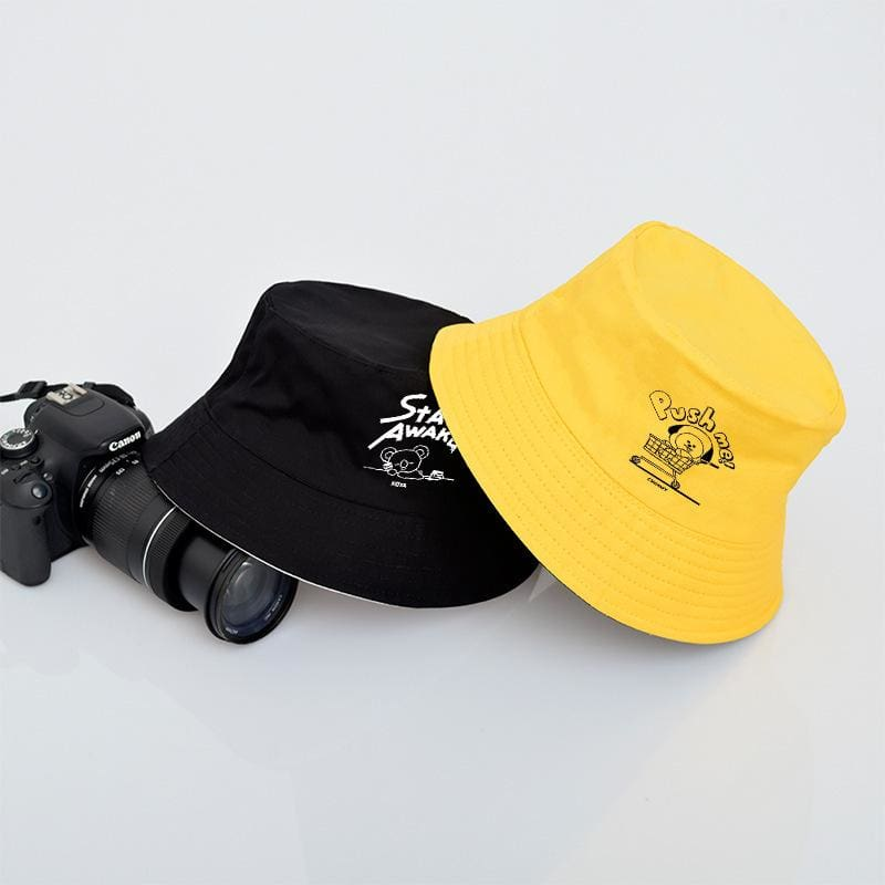 a yellow and black hat
