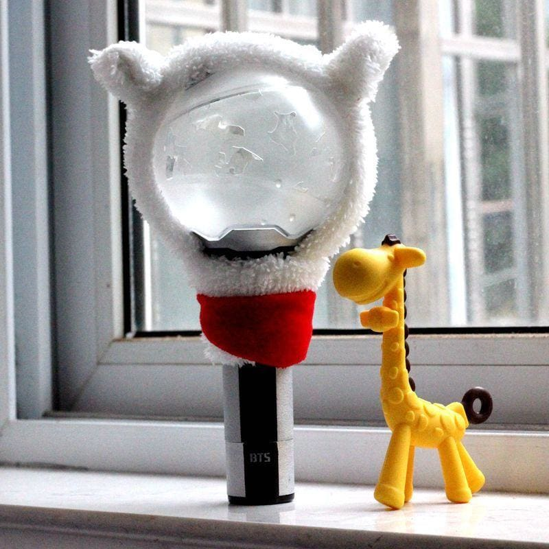 a yellow stuffed animal in front of a window