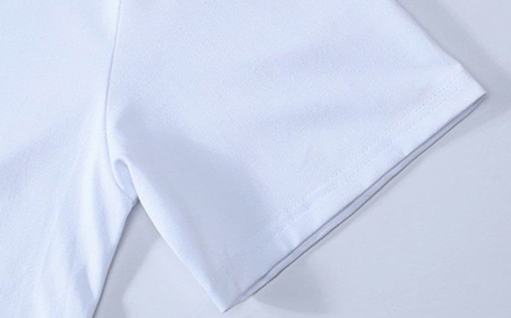 a close up of a man in a white shirt
