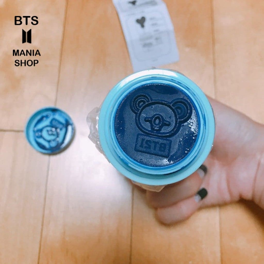 a hand holding a blue frisbee