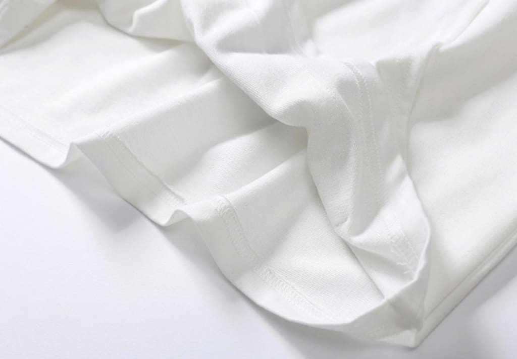 a close up of a white bed