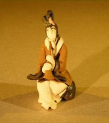 Female Musician Mud Figurine-Playing Wind Instrument