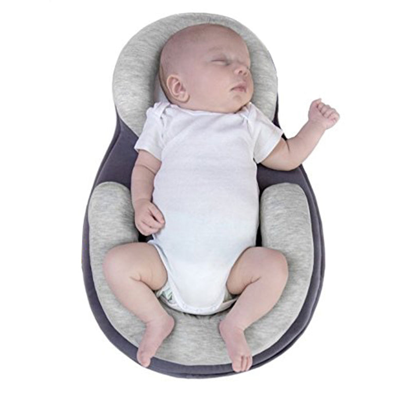 Newborn Anti-rollover elegant Pillow Elegant and quality anti-rollover pillow that  allows air to circulate around the baby.