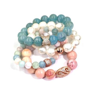 Blue aquamarine bracelets show in a stacking combination