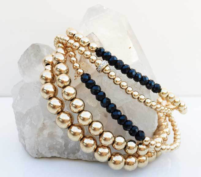 set of bracelents on a white stone