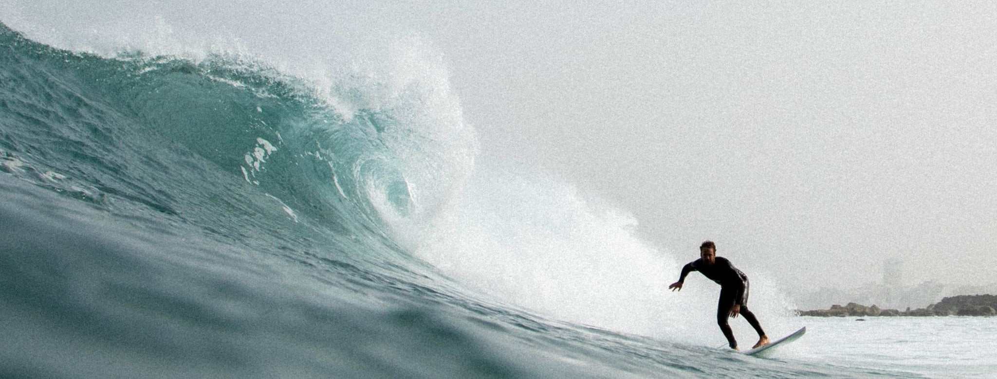 surfer on the bottom of a large wave in the ocean at the coast of the canary islands surfing