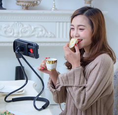 Lazy Phone Holder iPhone Black On Table Woman Eating