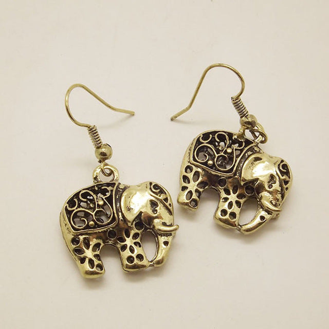 Unique Tibetan Carved Earrings - Sunflower Musk