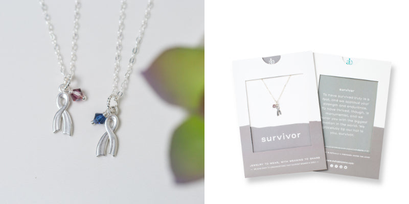 Silver Ribbon Necklace with Pink or Blue Crystal, 'Survivor' by Asha Blooms in a Flat Lay and Gift Packaging photo