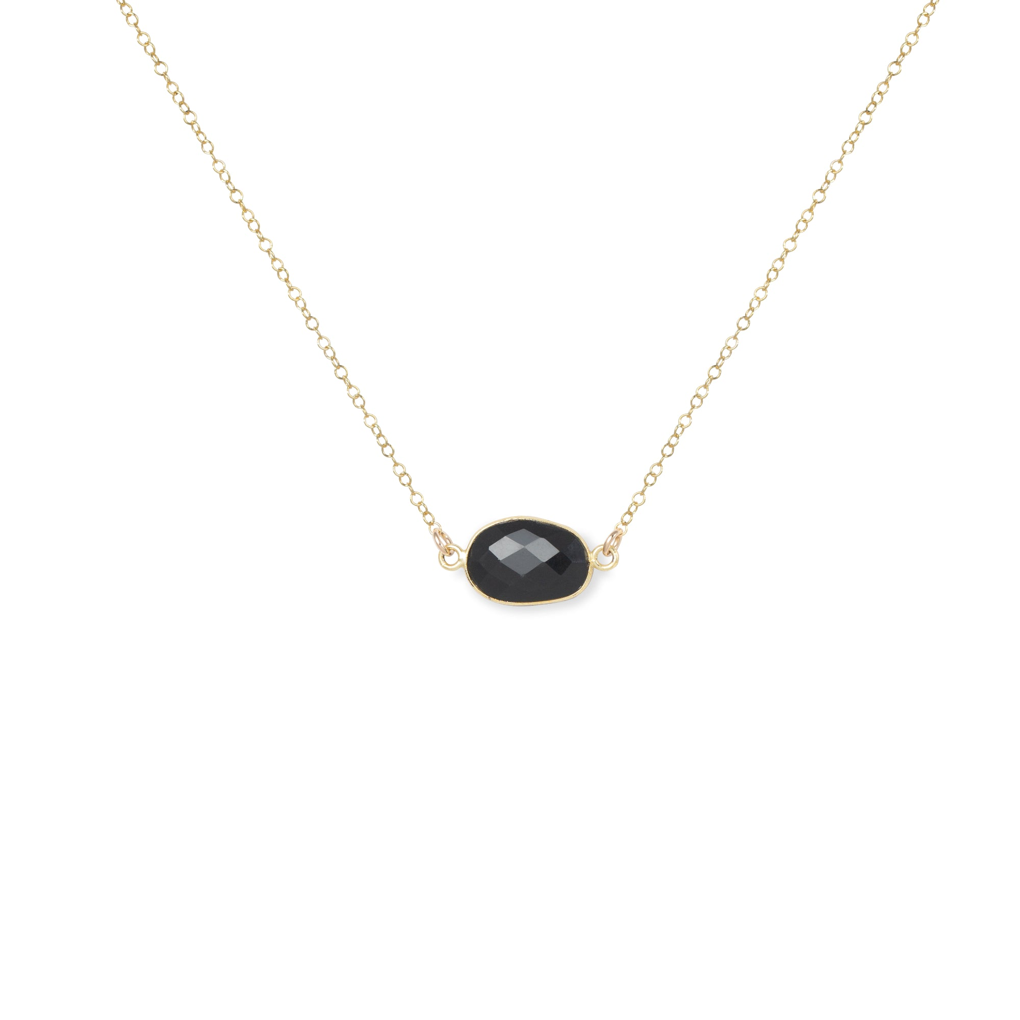 Close-up of Oval-shaped Spinel and Gold Necklace 'I Am Badass' on White Background Product Photo by Asha Blooms