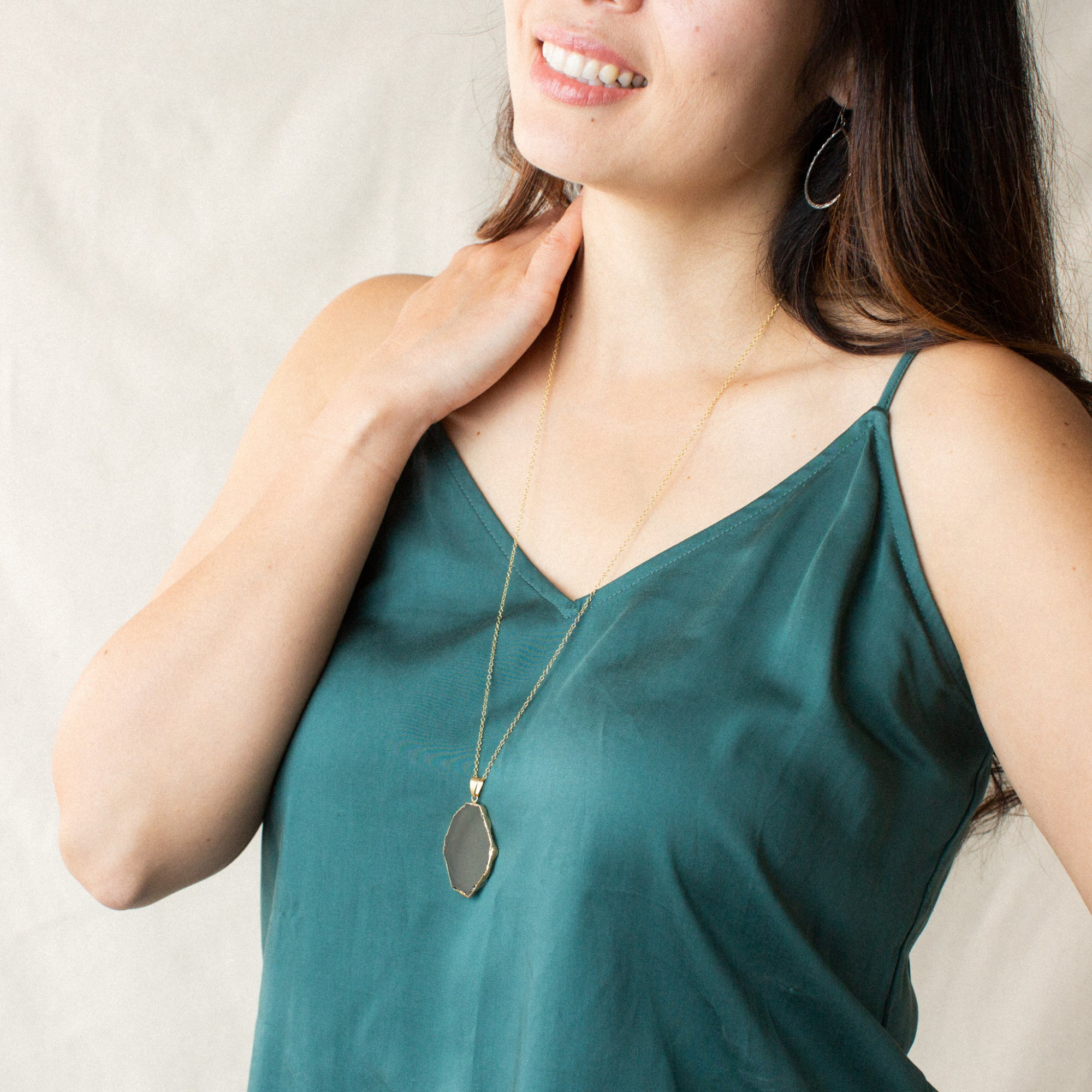 Womean in Green Shirt Smiling and Wearing Slice-shaped Smoky Quartz and Gold Long Necklace 'I Am Brave' Model Photo by Asha Blooms