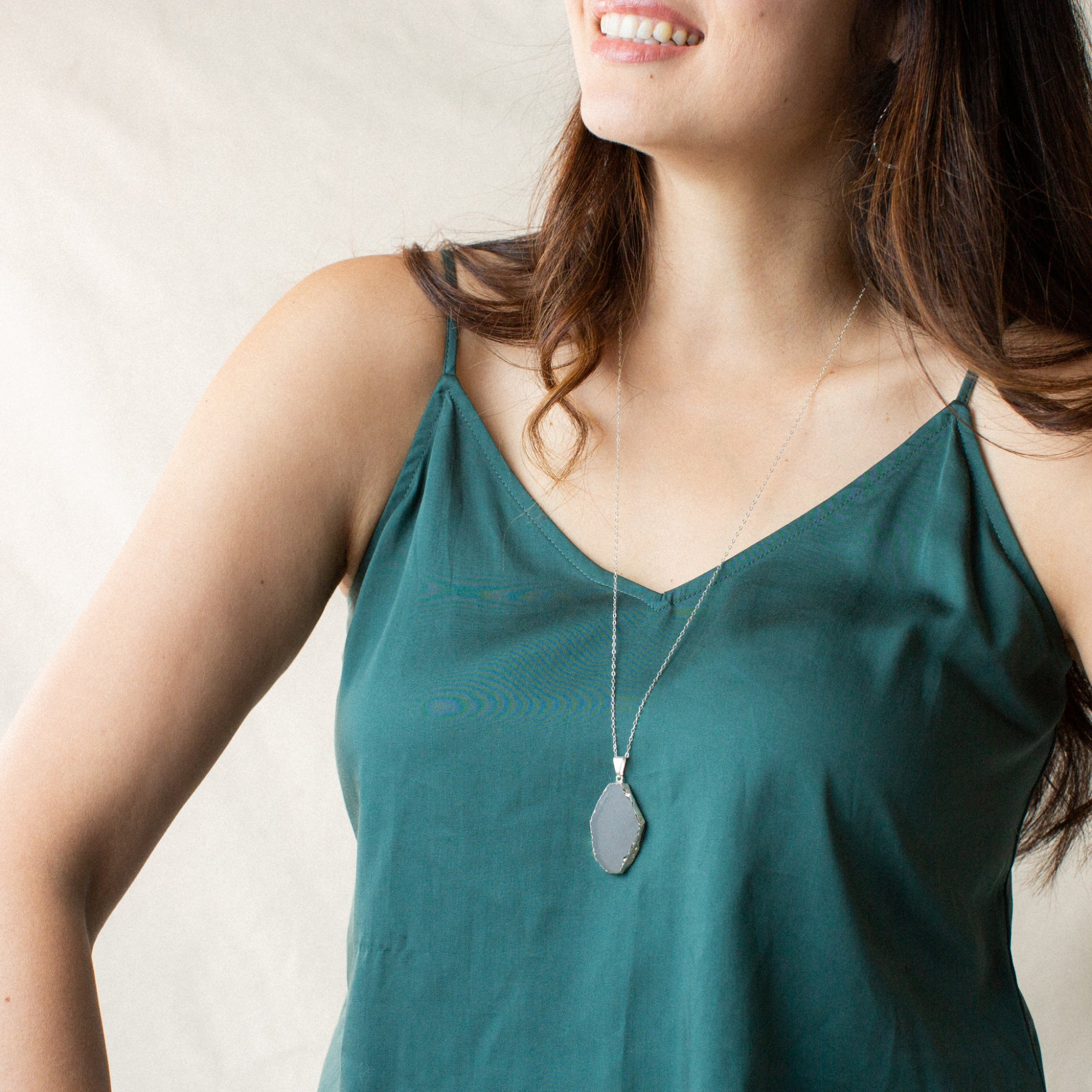 Woman in Green Shirt Smiling and Wearing Slice-shaped Smoky Quartz and Silver Long Necklace 'I Am Brave' Model Photo by Asha Blooms