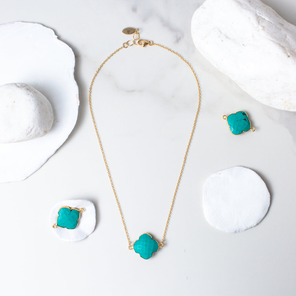 Clover-shaped Turquoise and Gold Necklace 'I Am Complete' Flat Lay with White Stones Photo by Asha Blooms