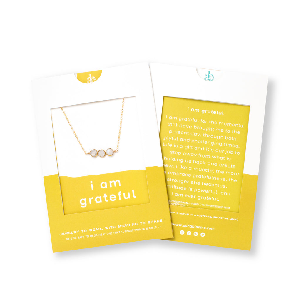 Three Small Circle-shaped Stones Side-by-side in Moonstone and Gold Necklace 'I Am Grateful' in Yellow Gift Message Sleeve Packaging Photo by Asha Blooms