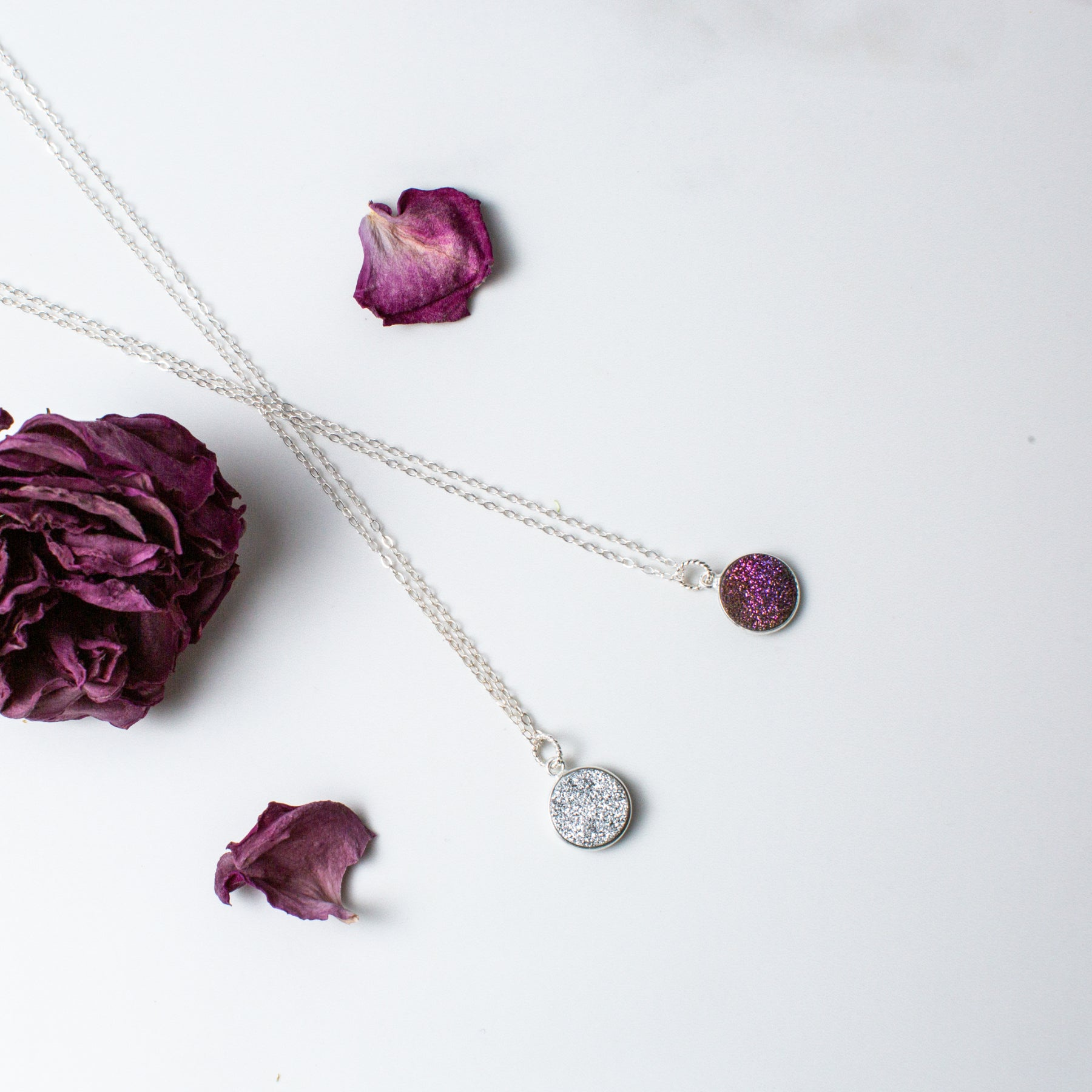 Circular Purple or Silver Druzy and Silver Necklace 'I Am Happy' Flat Lay with Purple Flower Petals Photo by Asha Blooms