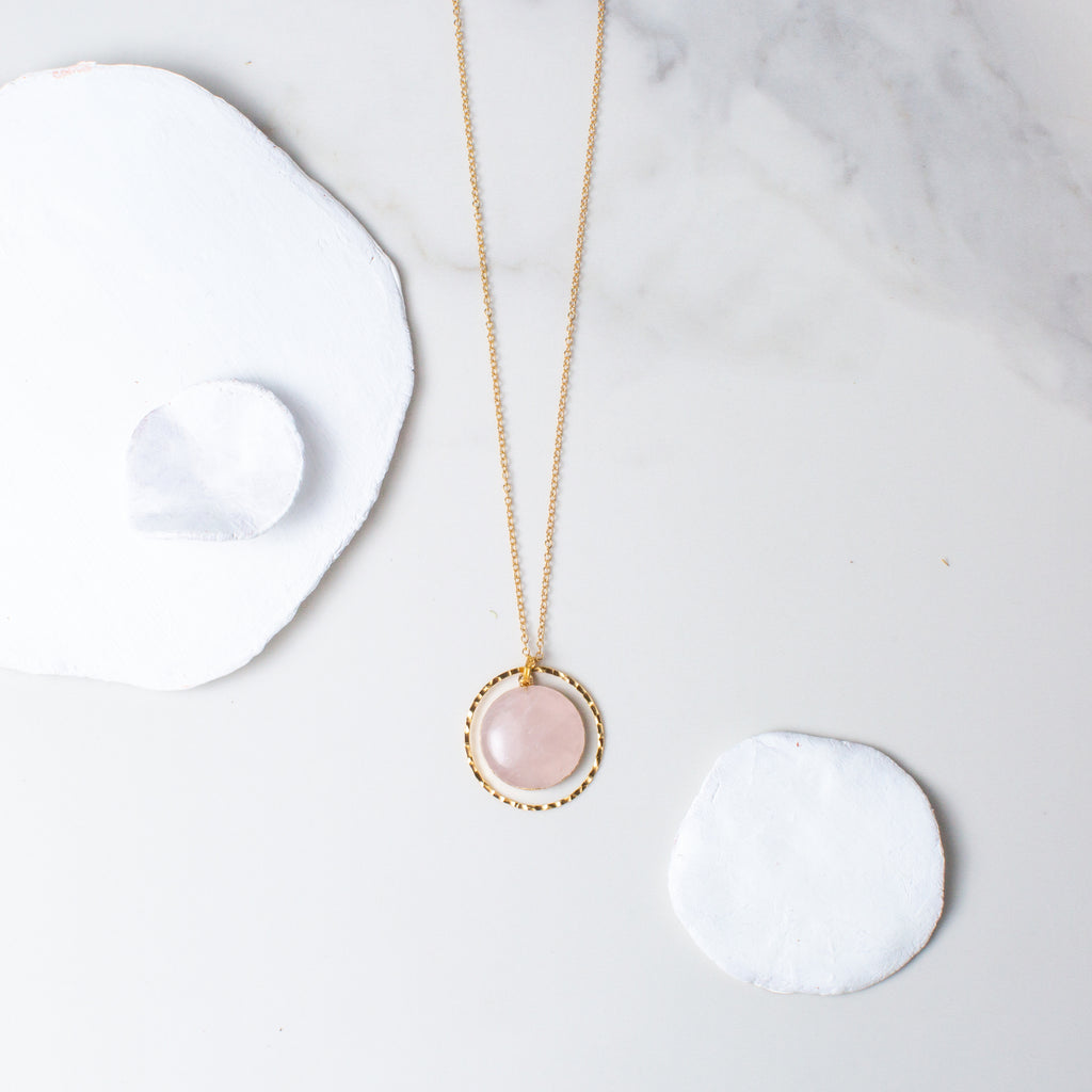 Circular Rose Quartz and Gold Hammered Circle Necklace 'I Am Loved' Flat Lay with White Stones Photo by Asha Blooms