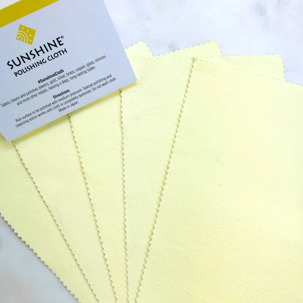 Five Yellow Jewelry Polishing Cloths with Sunshine Brand Sign Flat Lay Photo from Asha Blooms