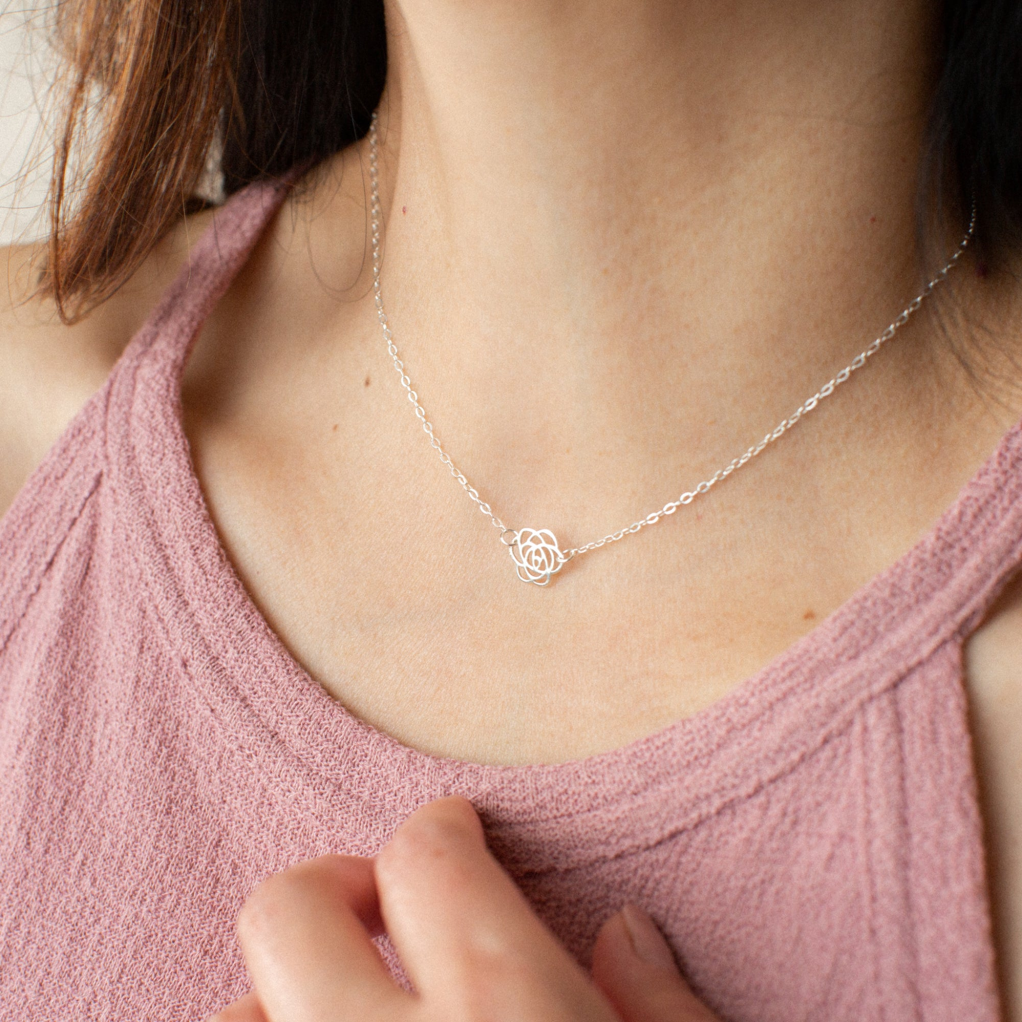 Close-up of Woman in Pink Shirt Wearing Silver Rose Pendant Necklace 'Thank You' Model Photo by Asha Blooms