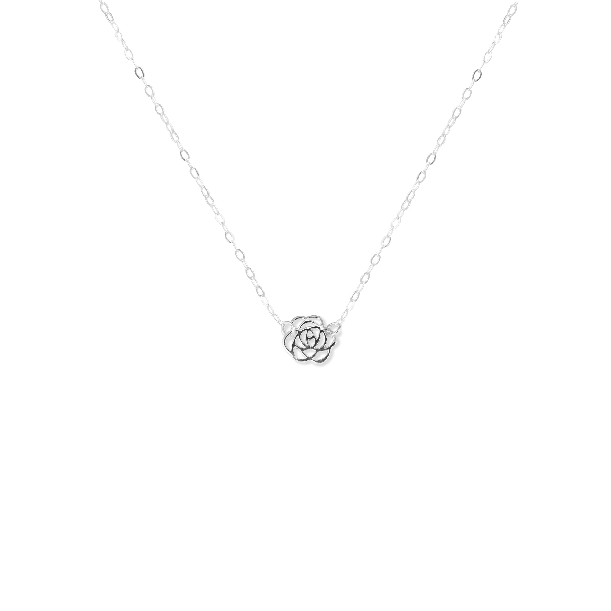 Close-up of Silver Rose Pendant Necklace 'Thank You' on White Background Photo by Asha Blooms