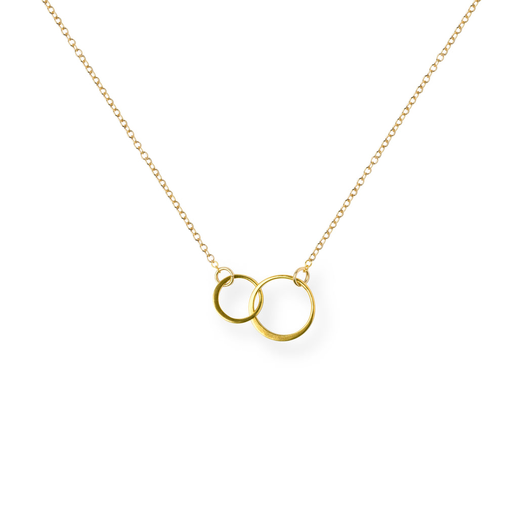 Close-up of Gold Linked Circles Necklace 'We Are Connected' on White Background Product Photo by Asha Blooms