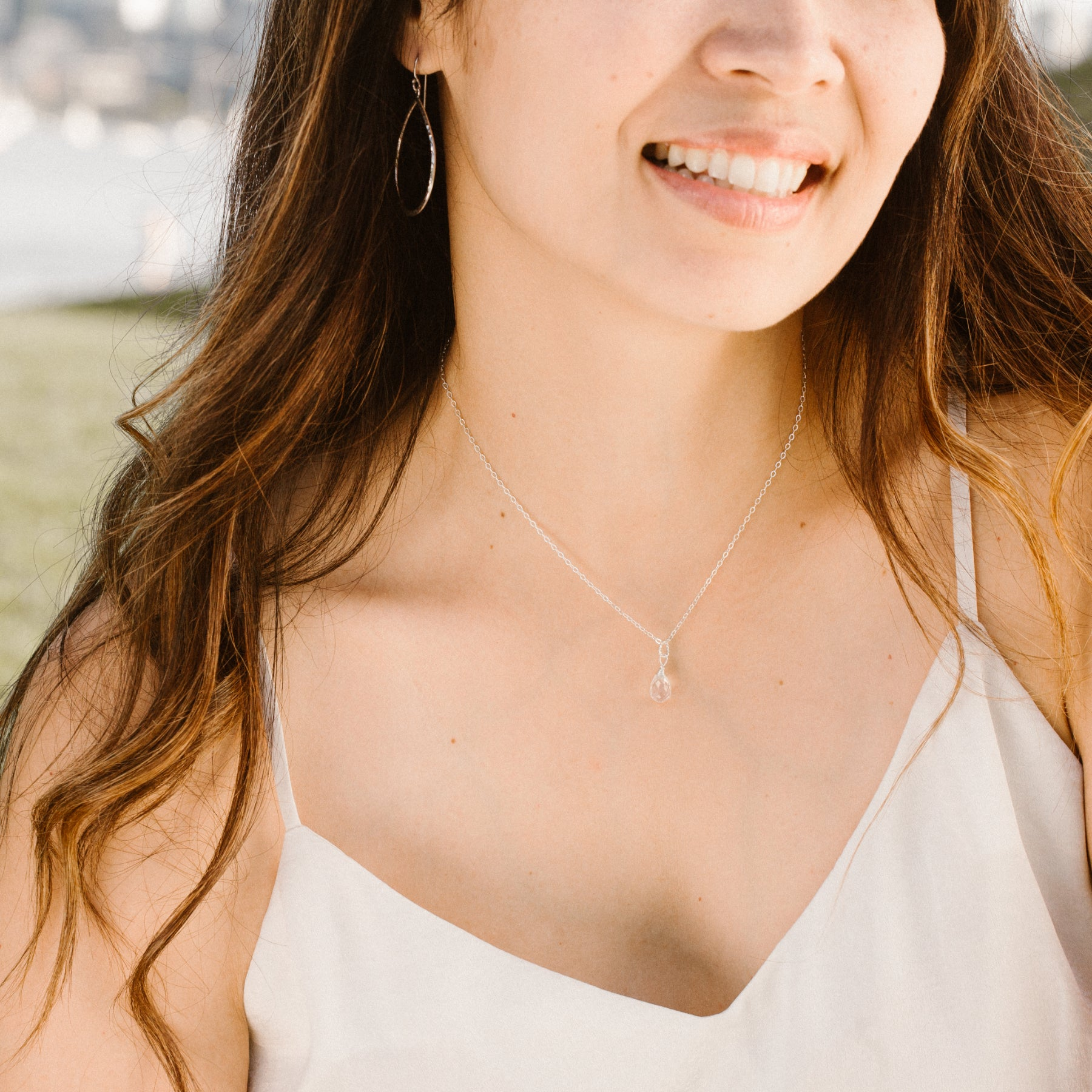 Woman in White Shirt Smiling and Wearing Teardrop-shaped Rose Quartz and Silver Necklace 'You Are Loved' Model Photo by Asha Blooms