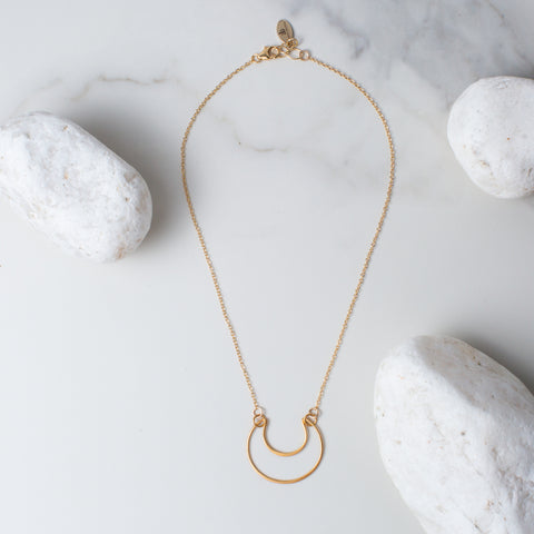 Gold or Silver Crescent Moon Pendant Necklace 'You Are Still Standing' Flat Lay with White Stones Photo by Asha Blooms