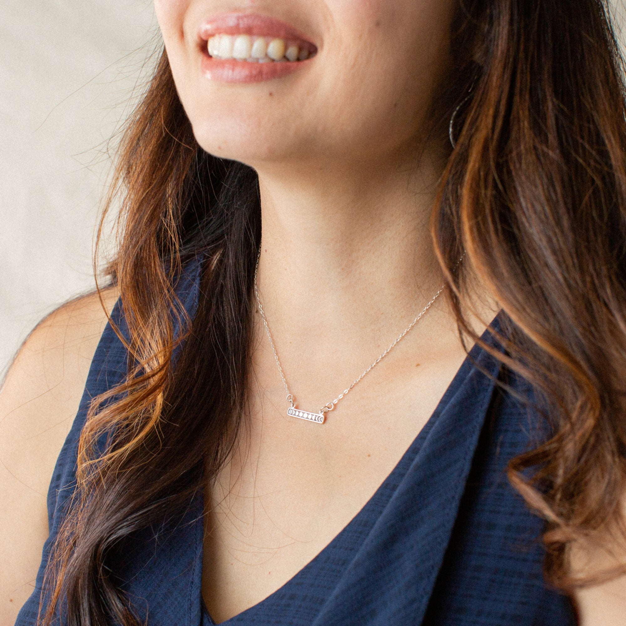 Woman in Blue Shirt Smiling and Wearing Silver Moon Phases Pendant Necklace 'You Are the Change' Model Photo by Asha Blooms