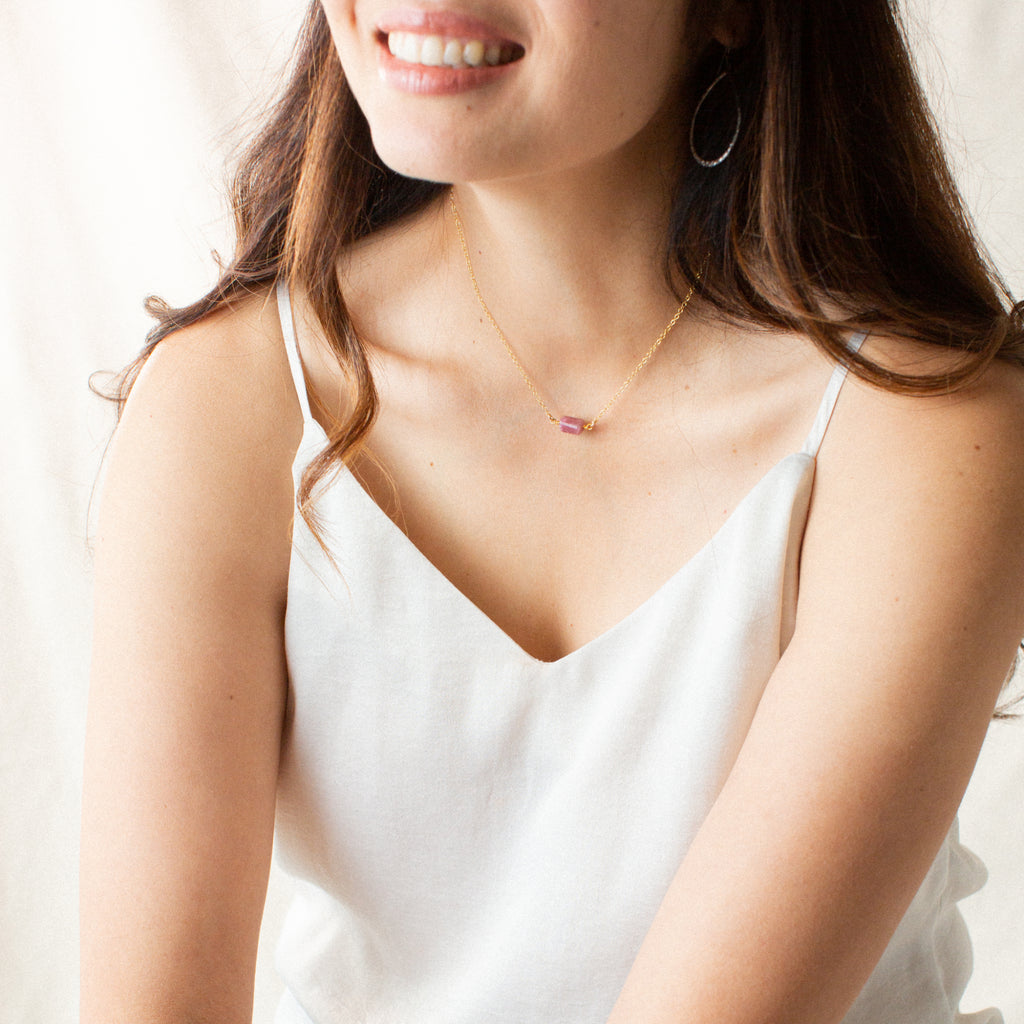 Woman in White Shirt Smiling and Wearing Rubellite Tourmaline and Gold Necklace 'You Rock' Model Photo by Asha Blooms