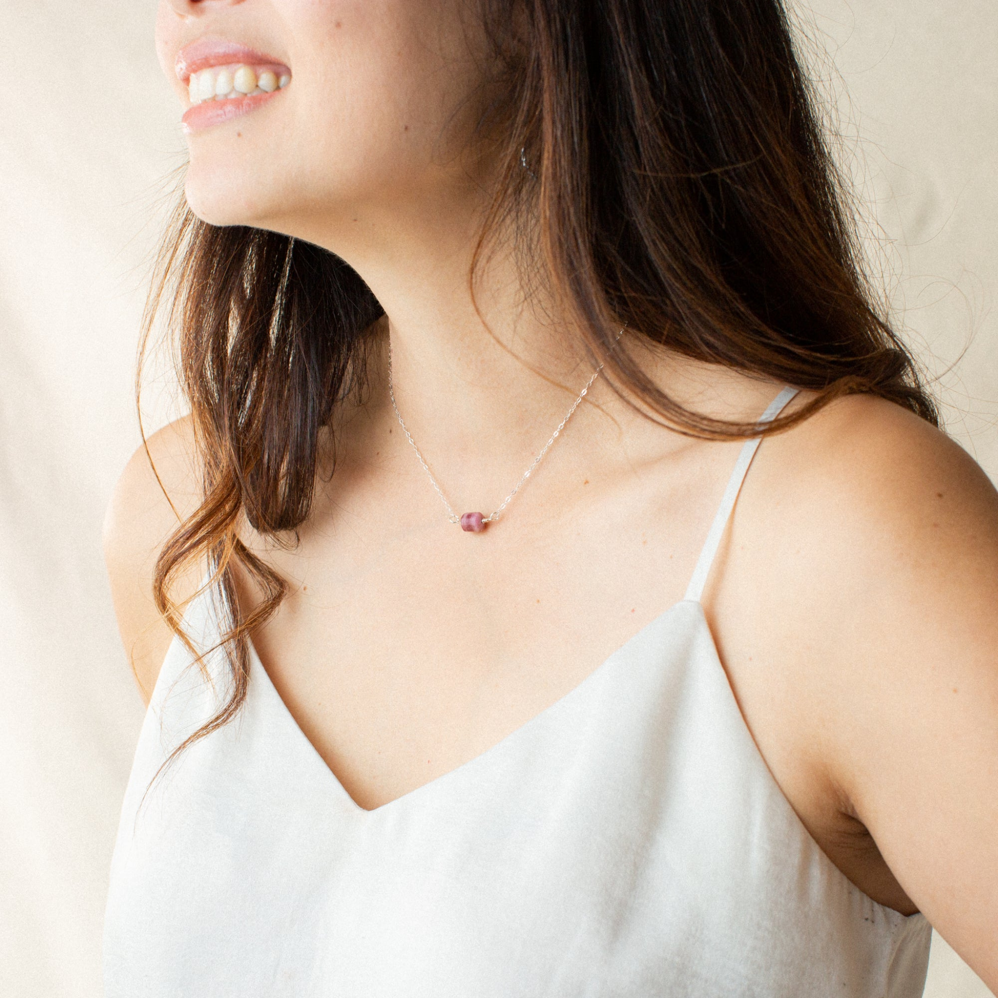 Woman in White Shirt Smiling and Wearing Rubellite Tourmaline and Silver Necklace 'You Rock' Model Photo by Asha Blooms