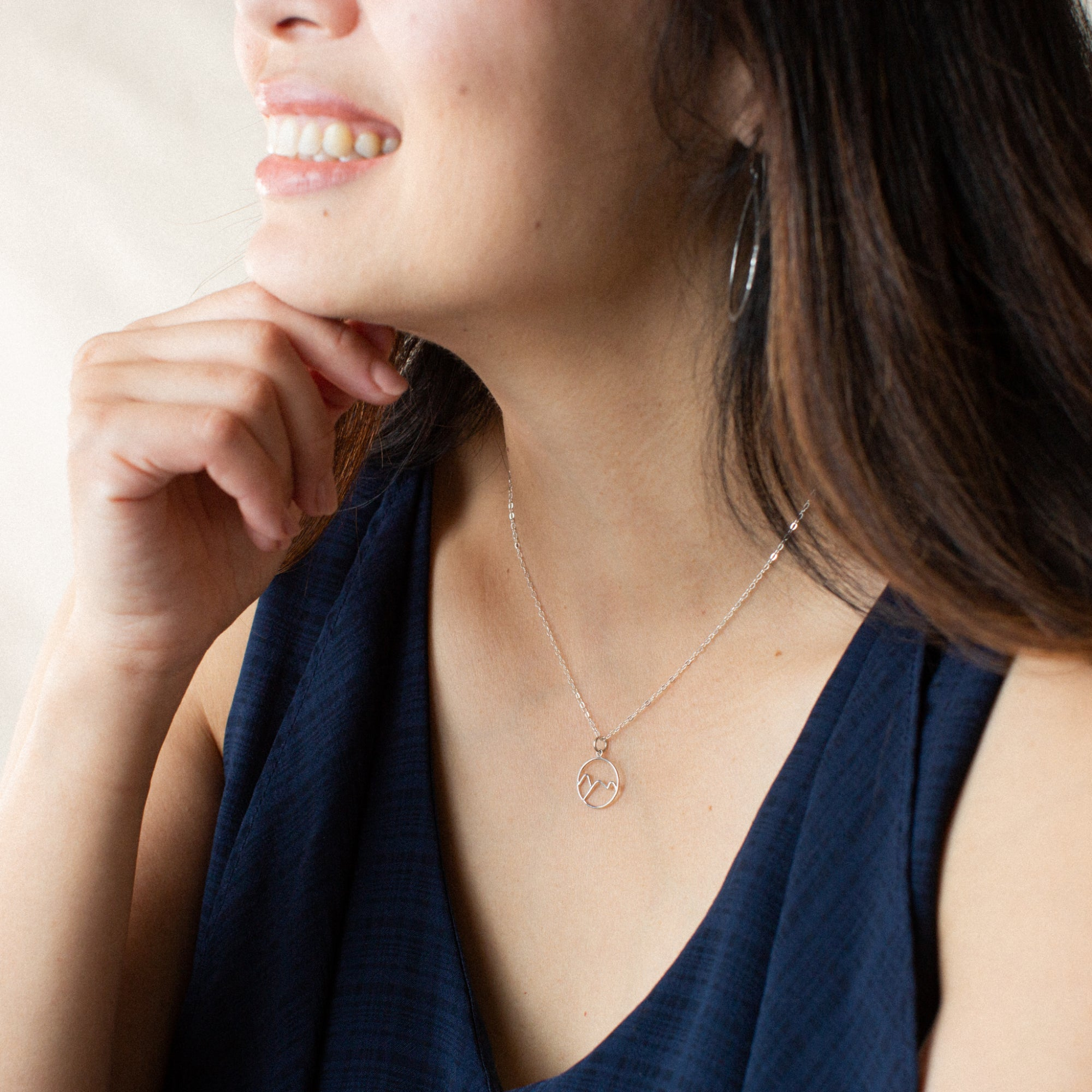 Woman in Blue Shirt Smiling and Wearing Silver Mountains Pendant Necklace 'You've Got This' Model Photo by Asha Blooms
