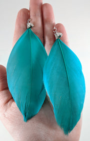 Rhinestone Feather Earrings (Dangles) - size comparison hand
