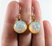 Double-Sided Galaxy Fleck Globe Earrings (Dangles) - size comparison hand