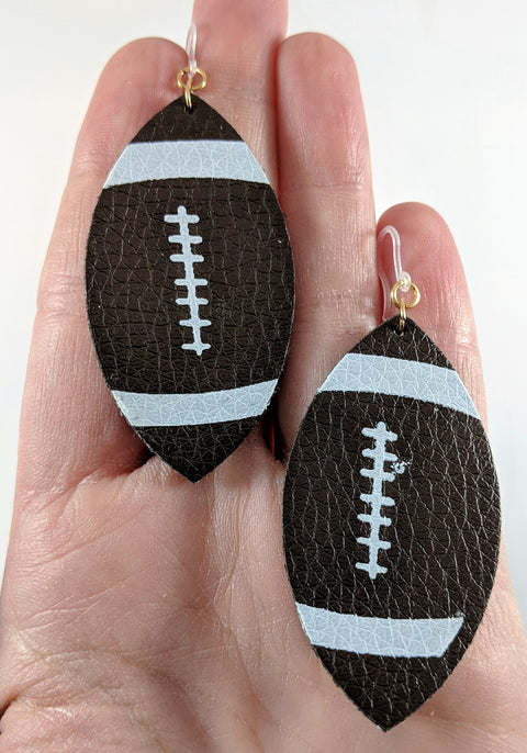 Football Teardrop Earrings (Teardrop Dangles) - size comparison hand