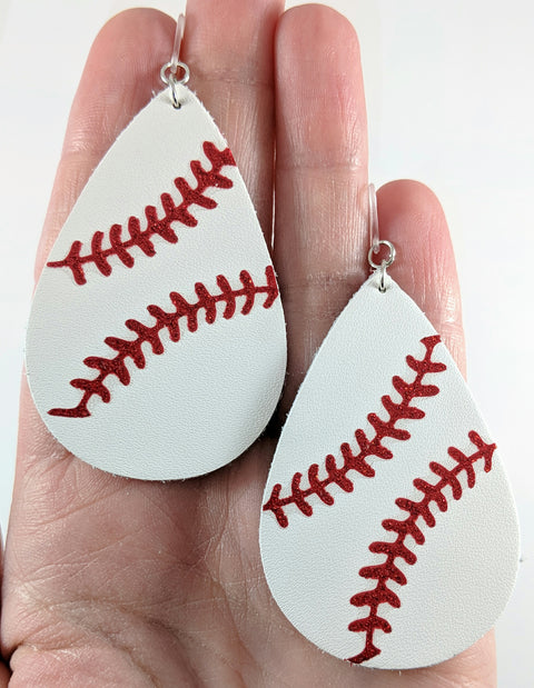 Baseball Stitch Earrings (Teardrop Dangles) - size comparison hand