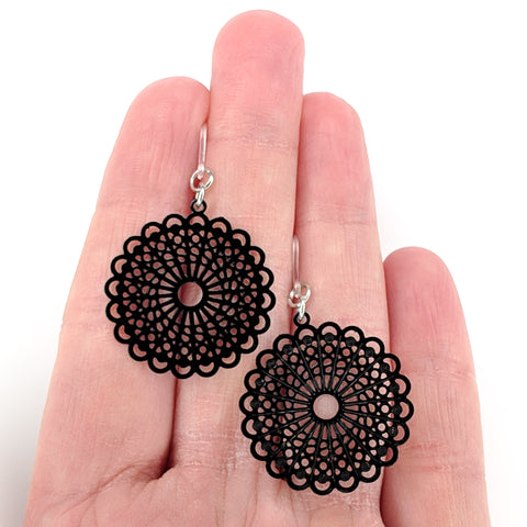 Burst Earrings (Dangles) - size comparison hand