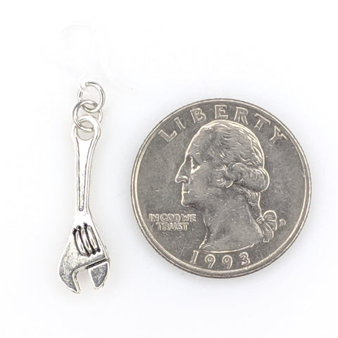 Monkey Wrench Earrings Product Image next to a quarter