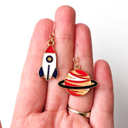 Rocket & Planet Earrings (Dangles) - size comparison hand