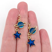 Blue Planet and Star Earrings (Dangles) - size comparison hand