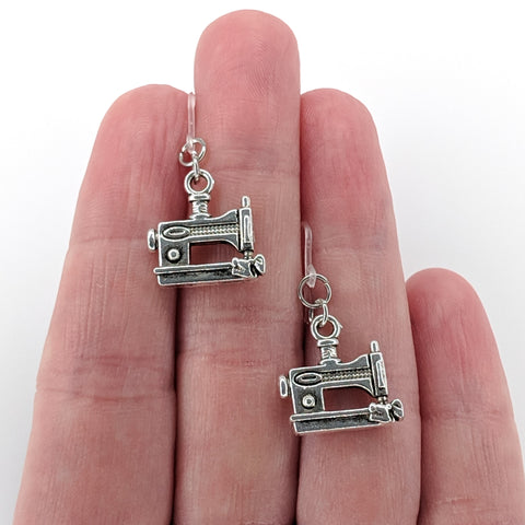 Silver Sewing Machine Earrings (Dangles) - size comparison hand