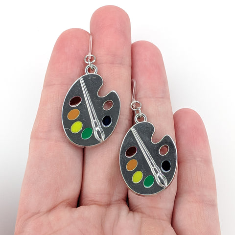 Silver Paint Palette Earrings (Dangles) - size comparison hand
